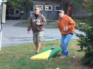 two men playing corn hole