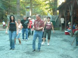 campers line dancing