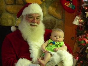 santa holding baby at circlel cg farm