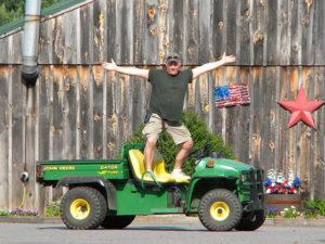 man standing on John Deere Gator