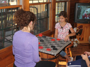 two girls playing checkers