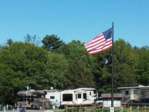 campsites with flag in the foreground