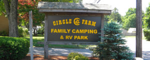 entrance sign to circle cg farm family camping and rv park