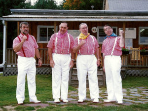 mens quartet dressed in white slacks and red and white striped shirts