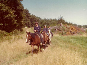old photo of trail ride